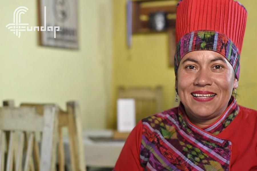 Idalia sonriendo en la Memoria de Actividades de FUNDAP